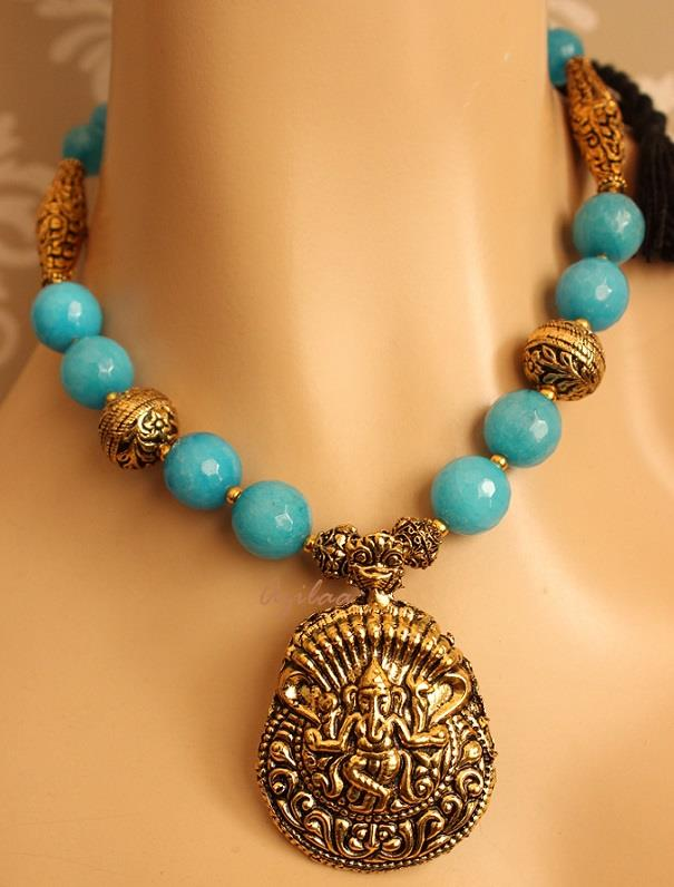 Ganesha pendant blue necklace set antique gold tone necklace set ganesha pendant blue necklace set antique gold tone necklace set online in india azilaa mozeypictures Choice Image