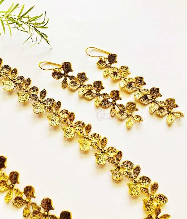 5667e41ad4 Modern Golden flower long necklace and earrings set at ₹2450 | Azilaa